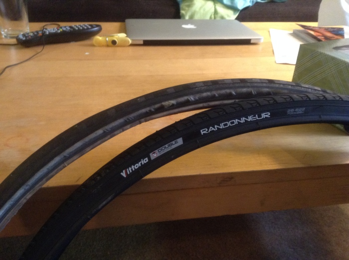 My old bike tire is behind the new one.