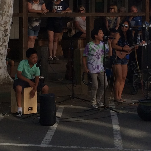 A bunch of Hawaiian kids played some covers on the street to earn money for college.