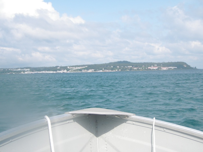 My uncle's piloting the family motor boat into Mackinac.